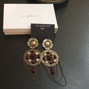Bronze and Maroon earrings. Comes with box.